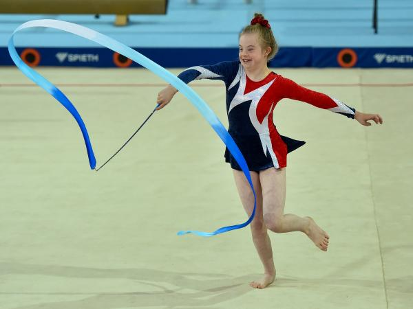 Special Olympics gymastic performing rhythmic gymnastics with ribbon