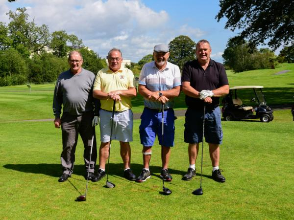 Four men pose during golf tournament organised for Special Olympics Ireland