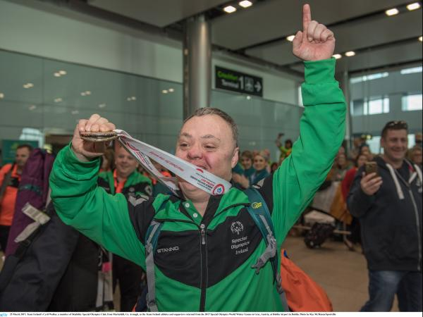 Cyril Walker returning home with his medal at Dublin Airport