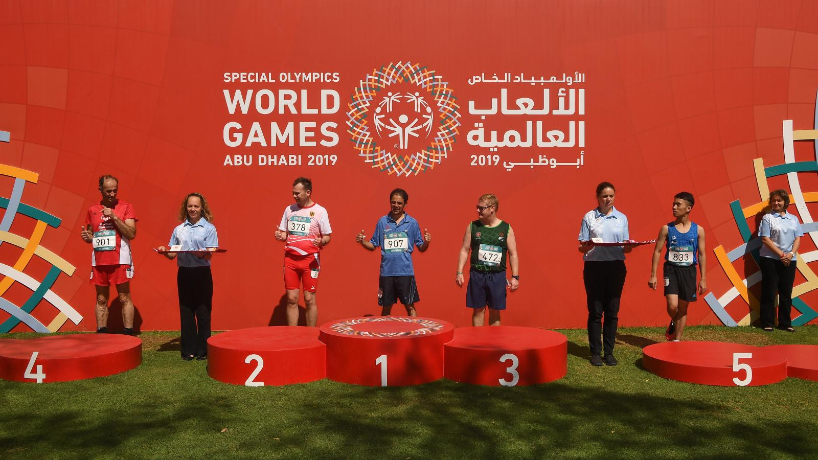 Athletes standing in front of presentation podium prior to medal presentation at World Games